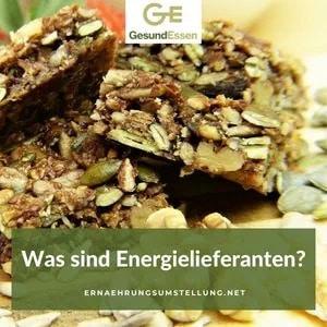 Zwei Menschen voller Energie - Text auf dem Bild: Was sind Energielieferanten?